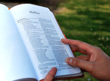 Book of Matthew - reading bible Stock Photo