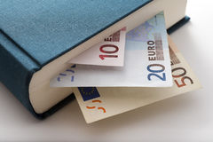 Book and money. Euro bill in a blue book Stock Images