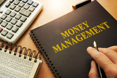 Book with money management. Book with money management on a table stock image