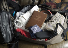 The Book of Mormon in packed mans suitcase Royalty Free Stock Photos