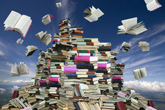 Book mountain. This is books mountain. Many books on background of white clouds and blue sky Stock Images