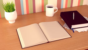 Book,mug and flowerpot on study table. Royalty Free Stock Photography