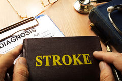 Book with name brain stroke disease. Medical concept Stock Photo