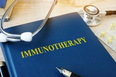 Book with name immunotherapy. Book with name immunotherapy and stethoscope royalty free stock images