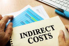 Book with name indirect costs. Business concept Stock Images