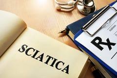 Book with name sciatica. Stock Photo
