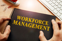 Book with name workforce management. Book with name workforce management in an office Stock Image