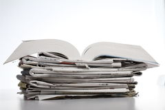 Book and newspaper Stock Images