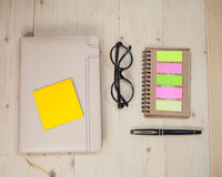 Book note with post it on wood Stock Photo