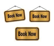 Book now - bronze signs Royalty Free Stock Photography