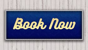 BOOK NOW handwritten on blue leather pattern painting hanging on wooden wall. Illustration Royalty Free Stock Photos