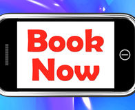Book Now On Phone Shows For Hotel Or Flight Reservation Royalty Free Stock Photography