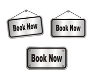 Book now - silver signs Royalty Free Stock Photo