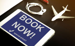 Book now travel agency website on Tablet screen. Stock Photos