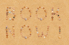 Book now wording on the beach Stock Images