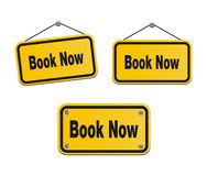 Book now - yellow signs Royalty Free Stock Image