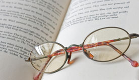 Book & old eyeglass. Old eyeglass on the book Royalty Free Stock Image