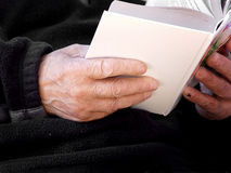 Book in old hands royalty free stock photo