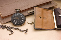 Book, old watch and money Royalty Free Stock Photo