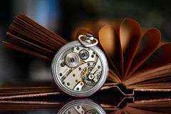 Book and old watch. Old stuff - old pocket watch and book Royalty Free Stock Photography
