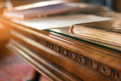 Book on old wooden table. Desk and sunlight. Study history and uncover secrets Royalty Free Stock Image