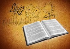 Book open against drawings of nature on orange background Royalty Free Stock Photo