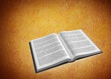 Book open against orange background Royalty Free Stock Image