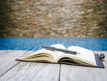 Book open page with pen on wooden background Stock Images