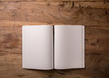 Book opened blank on dark wooden background with copy-space, top Royalty Free Stock Photo