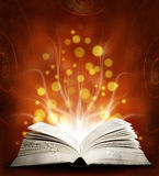 Book. Opened magic book with magic light. Educatio Royalty Free Stock Photos