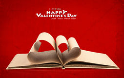 Book with opened pages of shape of heart Stock Photo