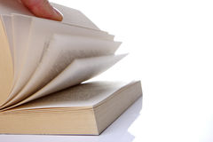 Book opening with hand from man. The book is scrolled by one hand Royalty Free Stock Photo