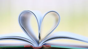 Book page in heart shape Stock Photography