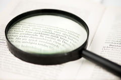 Book Page and Magnifying Glass Royalty Free Stock Photos