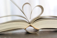 Book page. Old book page in heart shape Stock Images