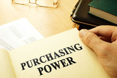 Book with page about purchasing power. Royalty Free Stock Images