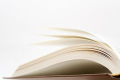 Book pages. Against white background, shallow focus stock photography