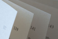 Book pages closeup. With page numbers Stock Photos