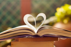 Book pages curve into heart shape,. Book pages curve into heart shape royalty free stock image