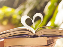 Book pages curve into heart shape. Book pages curve into heart shape stock image