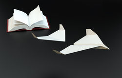 Book pages flying of as paper planes Stock Photography