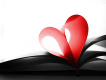 Book pages folded as heart Royalty Free Stock Photography