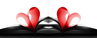 Book pages folded as heart Stock Photos