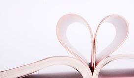 Book pages folded into a heart shape Royalty Free Stock Image