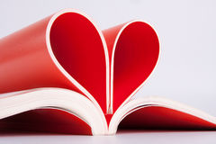 Book pages folded into a heart shape Stock Photos