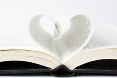 Book with pages folded into a heart shape Royalty Free Stock Images