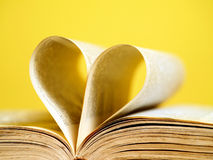 Book pages folded to create a heart Royalty Free Stock Photo