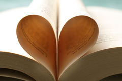 Book pages forming heart Stock Photos