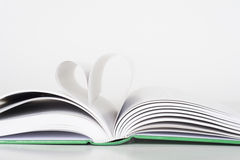 Book - Pages making Heart. White background Stock Image