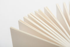 Book pages. Open book pages in white background, close-up Stock Photos